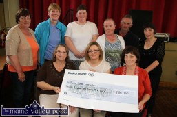 Cora O'Brien (front centre) receiving a cheque on behalf of Pieta House from the proceeds of the 2013 Carmel Linehan memorial Run / Walk committee at Knocknagoshel Community Centre. Making the presentation are: Bridget Scanlon (left) and Catherine Brosnan. back from left: Catherine Brosnan, Mary McAuliffe, Catherine Browne, Eileen O'Connor, Nelius Linehan and Marie O'Callaghan. ©Photograph: John Reidy 15-8-2014