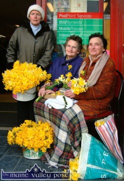 Daffodil Day sellers, Betty Walsh (left) with Marie Downey and Eily Curtin pictured at front door of Garvey's SuperValu on Castleisland's Main Street. ©Photograph: John Reidy 19-3-2004