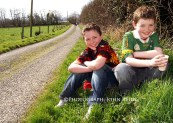 Fine Day - No Hurry would appear to be the motto of Christopher Kerley (left) and Cillian Hickey as they stop for a break during the seventh annual Good Friday morning Kerry Hospice Foundation fundraising walk in Castleisland. ©Photograph: John Reidy 25-3-2005