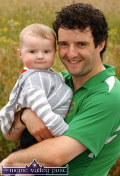 Nine-month-old, Bobby McCarthy from Castleisland pictured in dad, Jason's arms at the inaugural Carmel Linehan Memorial Walk in Knocknagoshel on a Sunday afternoon in 2009. ©Photograph: John Reidy 28/06/2009