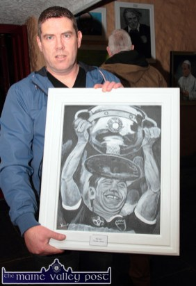 Castleisland artist, Kevin Barry with his 'Paidí Ó Sé' painting at the opening of his exhibition at the Ivy Leaft Art Centre on Friday night. Photo by John Reidy