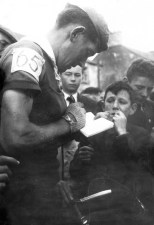 The late Johnny Drumm signing an autograph for Castleisland youngster, Paul Geaney in 1963. The Rás Tailteann of 1963 included a stage end and start in Castleisland on July 10th and 11th and Johnny Drumm wore number 65 that year. The number is sadly and tragically prophetic as he died in a farm accident in September 1965. Photograph Courtesy of the Marie Drumm-Walsh's Collection.
