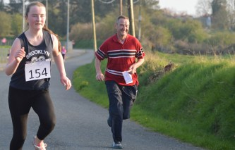 Róisín and Pat Brosnan sprinting to the finish line after completing Friday evening's Kilmurry National School 5K fundraiser. Photograph: Nora Fealey.