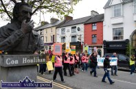 Heading for the Latin Quarter: The Right2Water Castleisland protest march passing the Con Houlihan monument on Main Street on Saturday afternoon. ©Photograph: John Reidy