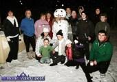 The late Liz Walmsley (fourth from left) with neighbours in Castleisland's St. Stephen's Park delighted with their creation 'Stephen Snowman' during the early January 2010 snowfall. Included are front from left: Stacey O'Sullivan, Kealan Downey, Becky Hussey, Labhaoise Walmsley and Gary O'Sullivan. Back row from left: Rosie Downey, Michelle Walmsley, Mary O'Sullivan, Liz Walmsley, Shane O'Connor, Darragh McSweeney, Stephen McCarthy, Bernard Nolan, Joanne Walmsley and Derek Hussey. ©Photograph: John Reidy 10-1-2010