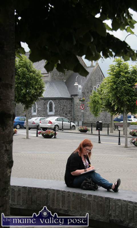 Fitting in: Visitor, Susan Lynch looked the part during the Listowel Writers' Week programme of events. She was actually doing a magazine puzzle in the inspiring atmosphere of the cultural stronghold on Saturday afternoon. ©Photograph: John Reidy 5-6-2010