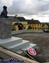 Everything Stops for Tea: The monument to Patrick O'Keeffe maintains a vigil over the village and on the workmen's tools during a tea-break in the World Fiddle Day preparations in Scartaglin on Thursday morning. ©Photograph: John Reidy