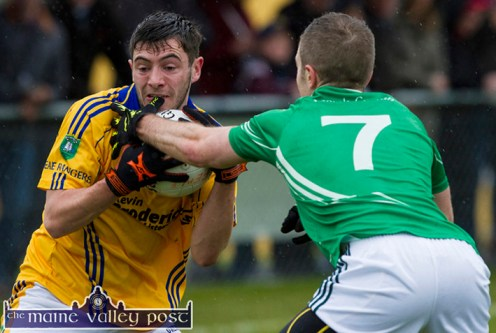 Feale Rangers' David Foran holds on to possession as St. Kieran's Maurice Hickey challenges him during their Garvey's SuperValu County Senior Football Championship first round game in Páirc na gCúlach in Cordal on Saturday evening. ©Photograph: john Reidy