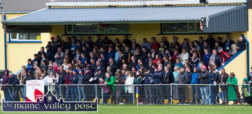 Supporters availing of the welcome shelter of the new stand during the Garvey's SuperValu County Senior Football Championship first round game in Páirc na gCúlach in Cordal on Saturday evening. ©Photograph: john Reidy