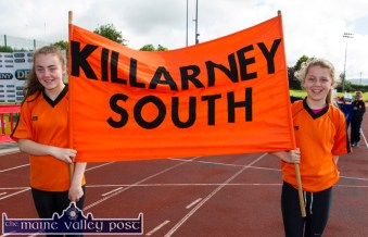 Ellen Moloney and Hollie Spellman proudly carry their team's flag into the Denny Kerry Community Games Athletics Finals at An Riocht AC, Castleisland on Saturday morning. ©Photograph: John Reidy