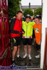 Tomás Ó Conchúir (left) pictured with Caroline Martin and Seán Hickey at Tom McCarthy's hall door at the start of the second annual Longest Day Cycle/Climb/Cycle Challenge in Castleisland on Saturday morning. ©Photograph: John Reidy