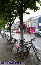 In the Early Morning Rain: Bikes await their riders on the island at the start of the second annual Longest Day Cycle/Climb/Cycle Challenge in Castleisland on Saturday morning. ©Photograph: John Reidy