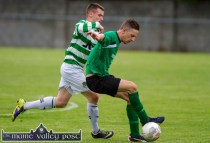 Goalscorer, Dean Poolman about to veer away from the challenge of Listowel Celtic's Bryan Murphy during Friday night's drawn Greyhound Bar Cup Final at Mounthawk Park, Tralee. ©Photograph: John Reidy
