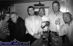 Con Houlihan is greeted on his return to his home town by his cousin Caroline Martin - with from left: Mark O'Connor, Billy Browne with Rugby star, Mick Galwey and John Browne. ©Photograph: John Reidy 17-9-2002