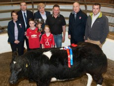 Jerry Devitt, Doon, Knocknagree (centre) pictured with his children, Jack and Ellen as he was presented with the IFA Perpetual Cup after his Belgian Blue Heifer was declared supreme champion at the annual Weanling Show and Sale at Castleisland Co-Op Mart. Manager, Richard Harnett made the presentation and included are: Marian O'Connell, AIB, Castleisland; Pat McTigue, AIB Tralee; Ger O'Connor, manager AIB Castleisland and Denis Griffin, IFA.