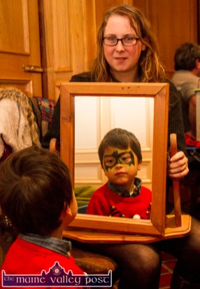 Mirror Image: Facepainter, Jane Carmody, Tralee showing Regan Zhang from Ballymacelligott his new look at the Castleisland Christmas Craft Fair at the River Island Hotel on Saturday. © Photograph: John Reidy