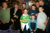 Cáit in the county colours before it became a reality for her. She's pictured here in Fagin's Bar for the singing workshop during the 2002 Patrick O'Keeffe Traditional Music Festival in Castleisland with: Pats Broderick (left) and Bob O'Rourke, and Martin, John, Dan, Cáit, Seán, Tomás and Donal Lynch. ©Photograph: John Reidy 26/10/2002