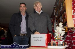 Tom O'Connor (left) and Richard Harnett making their contributions to the collection box at the annual GOAL Mile at An Riocht AC on Christmas Morning. ©Photograph: John Reidy