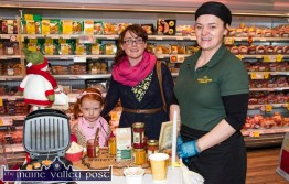 Katie Mangan, Ballymacelligott pictured with her mom, Karina and Audrey Frost demonstrating the Natural Larder Company products at the annual Garvey's SuperValu Food Fair in Castleisland. ©Photograph: John Reidy