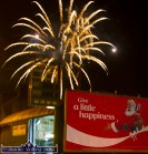 The advert on the gable of Mike Roche's Garage says it all as the last of the Fireworks explode over Tralee Road after the Castleisland Chamber Alliance street party on Friday night. ©Photograph: John Reidy