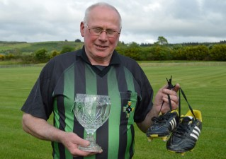 Cordal's Tom Wrenn hangs up his boots after he announced his retirement from refereeing with over fifteen years of service. Tom was presented with a piece of Waterford Crystal for his dedicated service by Tim Ryan, chairperson of East Kerry Board on that occasion. Photograph: Nora Fealey 27-5-2014