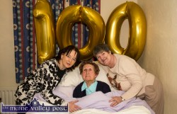 Happy 100th Birthday Nora: Mrs. Nora Curtin being congratulated on her 100th birthday by her carers, Lil Burke (left) and Bridie Begley at her home in Knightsmountain earlier today. ©Photograph: John Reidy