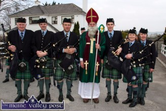 Joe Martin in the title role with members of the Cullen Pipe Band from left: Con Houlihan, Michael Doyle, Declan Buckley, Seamus Fleming, Colette O'Connor and Geraldine Houlihan before Thursday's St. Patrick's Day Parade in Castleisland. ©Photograph: John Reidy