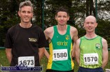 The first three home: Third place, Niall Shanahan, Limerick (left) with: Tim O'Connor, An Riocht AC, winner and Dónal O'Callaghan who finished second after the annual An Riocht AC / Lee Strand Kingdom Come 10 Miler and 5K Road Race in Castleisland this morning. ©Photograph: John Reidy