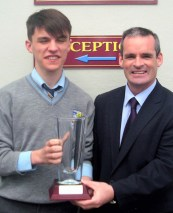 Principal Denis O'Donovan presenting The Principal's Award to Art O'Mahony.
