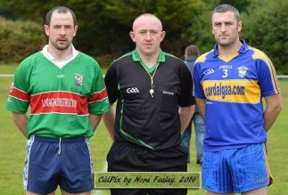 Tousist captain, Mike Tim O'Sullivan (left) and Cordal captain, John Brosnan pose for a photo with referee, Martin Boyle before the game last Sunday. ©CúlPix by Nora Fealey 2016