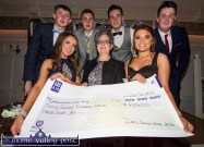 Breda Dyland (centre) represented the Cork Kerry Health Link Bus at the Castleisland Community College Debs Ball cheque presentation at the Earl of Desmond Hotel on Friday night. Included are members of the debs organising committee: Kayla Whooley (left) and Saoirse Casey. Back from left: Jack Flynn, Kieran Enright, Daniel Culloty and Jack Curran. ©Photograph: John Reidy