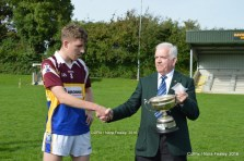 Cordal/Scart Captain, Kieran O'Donoghue being presented with League Cup from East Kerry Vice Chairman Johnny Brosnan. Photograph: CúlPix/Nora Fealey 2016©