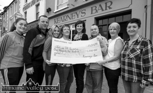 Cheque recipient, Sheila Hayes, Jack and Jill Foundation Liaison Nurse (centre right) with Betty O'Connell of Kearney's Bar (centre left) at the presentation of the coffee/tea jar charity fund proceeds. Included are: Rachael and Johnny O'Connell, Liz Broderick, Betty O'Connell and Sheila Hayes, Johnny Huggard, Bridget Reidy and Debra O'Connell. ©Photograph: John Reidy