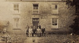 The Burke family outside the house in the early 1930s. Nell, Jeremiah, Norah and Jack. Back row - Andy, Denis and Bill.