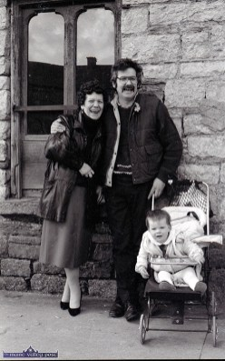 Maureen Sheils-Cronin and John Mitchell sharing a laugh with Baby Katie Mitchell at Dave Geaney's Corner during the first St. Patrick's Day Parade in Castleisland. ©Photograph: John Reidy 17-3-1989