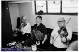 Paddy Cronin (left) Johnny O'Leary and Maurice O'Keeffe playing at Tom Fleming's Bar during the 1995 Scartaglin Féile Cheoil. ©Photograph: John Reidy 5/8/1995