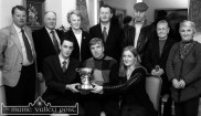 Gerard and Denise Griffin present Castleisland Day Care Centre Chairman, Jack Nolan (centre) with the Monty Griffin Memorial Perpetual Cup for the centre's annual Night at the Dogs fundraiser. Included are: John Pender, Donal Nelligan, Monica Prendiville, Michael Fitzgerald, David Fleming Daisy O'Connor and Joan McCarthy. The presentation was made on the occasion of the centre's first annual report. ©Photograph: John Reidy 13-3-2003