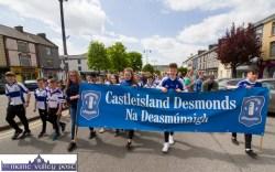 Castleisland Desmonds GAA Club banner bearers leading their club and supporters in the Coiste Na nÓg 50th anniversary parade in Castleisland on Sunday. ©Photograph: John Reidy