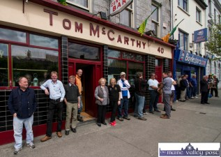 All out to watch the passing parade at Tom McCarthy's Bar as the Coiste Na nÓg 50th anniversary parade approached in Castleisland on Sunday. ©Photograph: John Reidy