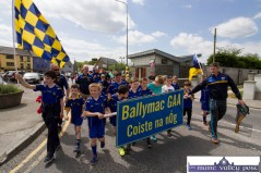 The Ballymacelligott boys being kept on track at the outset at the start of the Coiste Na nÓg 50th anniversary parade in Castleisland on Sunday. ©Photograph: John Reidy