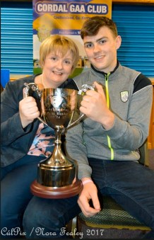 Sean O'Connell and his mom, Mary pose for a photo with the Munster Trophy at the reception in Cordal on Friday night. Photograph: CúlPix/Nora Fealey
