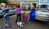 Four women and a dog: The scene outside Kearney's Bar this afternoon as the Galway Street Club put on an impromptu performance ahead of tonight's gig at the Castleisland Rugby Club grounds. ©Photograph: John Reidy