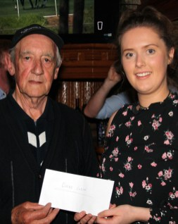 Leo Murphy, presenting the proceeds of the annual 5K and 10K Road Race / Fun Run to Sarah McCarthy who accepted on behalf of Glebe Lodge Residential Centre. The event is a memorial to Mr. Murphy's late son, Humphrey who was an inveterate fundraiser for many charities in the course of his all too short life. Photograph: Pat Hartnett