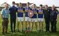 Richard O'Donoghue, Cathal O'Donoghue, Kieran O'Donoghue, Kieran Enright, Pádraig Brosnan, T.J O'Connor, Paddy Flynn and Andy O'Leary with the trophy after last Sunday's game in Ballybunion.
