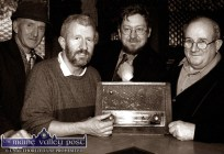 Tuning in: Pictured during the Céilí House recording at Brennan's Bar were, from left: Jackie Dan Jerry O'Connor, musician; Kieran Hanrahan, presenter; Peter Browne, producer and Sean Brennan, proprietor. The radio in the photograph belonged to the late Con Brosnan of Barrack Street. ©Photograph: John Reidy in 11-11-2002