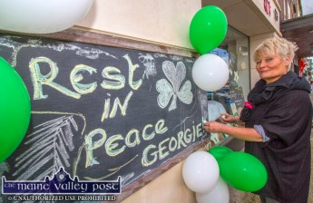 Kate Walsh scripting the Slice of Life Healthfood Store's tribute to a local community and sporting hero after the announcement of the death of Georgie O'Callaghan this week. ©Photograph: John Reidy