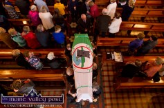 Draped in the flag of his beloved Castleisland AFC, Georgie O'Callaghan's remains are shouldered from the Church of Saints Stephen and John in Castleisland on Thursday. ©Photograph: John Reidy