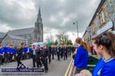 Castleisland AFC members shouldering the remains of their club's co-founder with family members and through a guard of honour of local students on Church Street on Thursday afternoon. ©Photograph; John Reidy