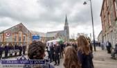 The scene on Church Street in Castleisland as Georgie O'Callaghan, funeral cortége moves through a guard of honour of local students on Church Street on Thursday afternoon. ©Photograph: John Reidy