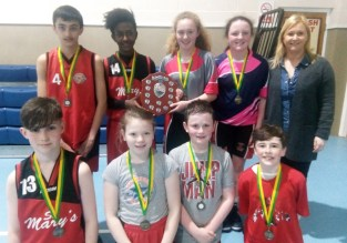 That Winning Feeling: The Chris Devane, Amy McCarthy, Cian Downey and Eoghan Shire. Back row: Evan Brennan, Mint O'Connor and Muireann Walsh' joint captains; Ciara Casey and Joanne Downey, coach at the 10th annual KDYS / Garda Good Friday Basketball Blitz at Castleisland Community Centre. Photograph: KDYS/ Garda